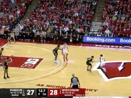 Wisconsin hits a layup on their final shot of the half to cover 1H -2 and hit the 1H over (56)