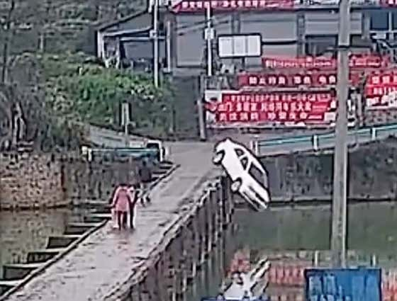 A Man In China Passed His Driver's Test Then Promptly Drove Off A Bridge And Crashed Into A River Because He Was Checking His Phone