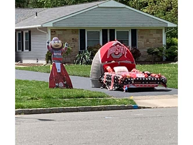 Why Is There a Full Ohio State Bed Setup At The Bottom Of My Neighbor's Driveway?