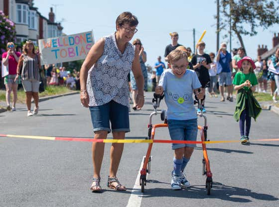 An Autistic Boy With Cerebral Palsy Walked A Marathon In 70 Days, Raising Over $100,000 For Children's Hospitals