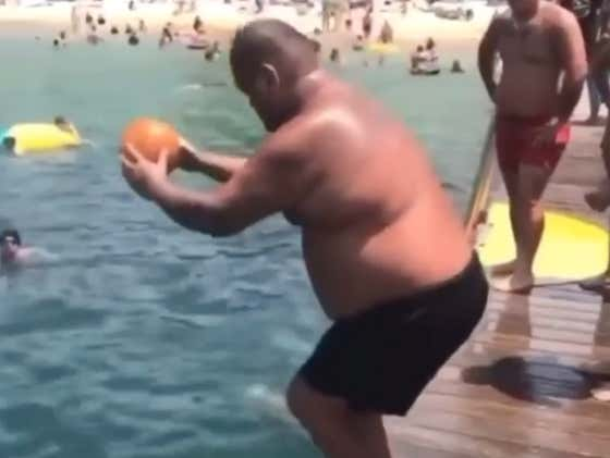 Check Out This Chunky Fella Launching A Beach Ball To The Moon
