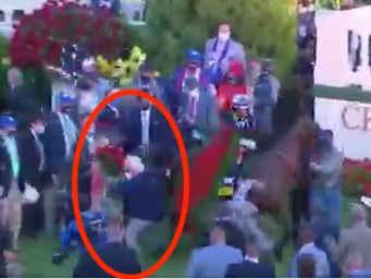 Bob Baffert Got Absolutely Bundled In The Winner's Circle By His Kentucky Derby Winning Horse Authentic