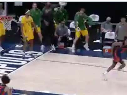The Only Thing More Impressive Than Baylor Last Night Was This Dude On Their Bench Mob Flexing And Holding People Back