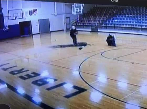 Watch This School Janitor Hit the Most Casual Backwards Half-Court Shot of All-Time