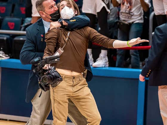 This A-10 Title Game Security Guard Hardo Has Waited His Entire Life For A Photographer To Come Onto His Court