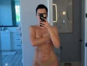 UPDATE: Khloe Kardashian Claps Back At The Haters By Filming Herself Jumping Around Naked In The Mirror