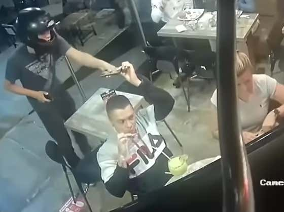 You Know The Chicken Wings Are Good When A Guy Refuses To Stop Eating Them As He Is Being Robbed At Gunpoint