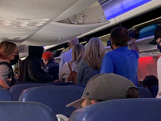 People Who Stand Up And Rush The Aisle When A Plane Lands Should Get The Death Penalty