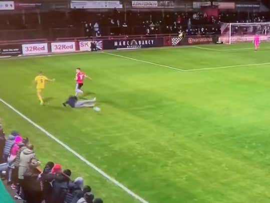 Gotta Support The Team: Fan Rushes The Field And Delivers A Perfect Slide Tackle To Stop The Opposing Team From Wasting Time