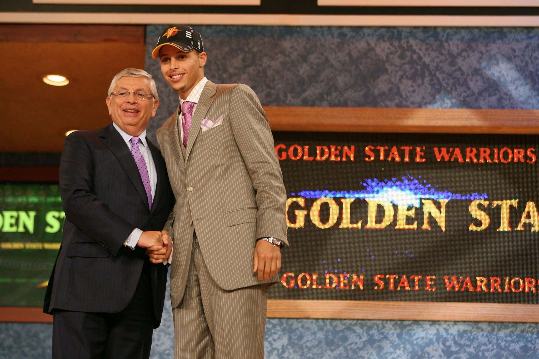 NEW YORK - JUNE 25:  Stephen Curry shakes hands with NBA Commissioner David Stern after being selected seventh by the Golden State Warriors during the 2009 NBA Draft on June 25, 2009 at the WaMu Theatre at Madison Square Garden in New York City. NOTE TO USER: User expressly acknowledges and agrees that, by downloading and/or using this Photograph, user is consenting to the terms and conditions of the Getty Images License Agreement. Mandatory Copyright Notice: Copyright 2009 NBAE (Photo by Nathaniel S. Butler/NBAE via Getty Images)