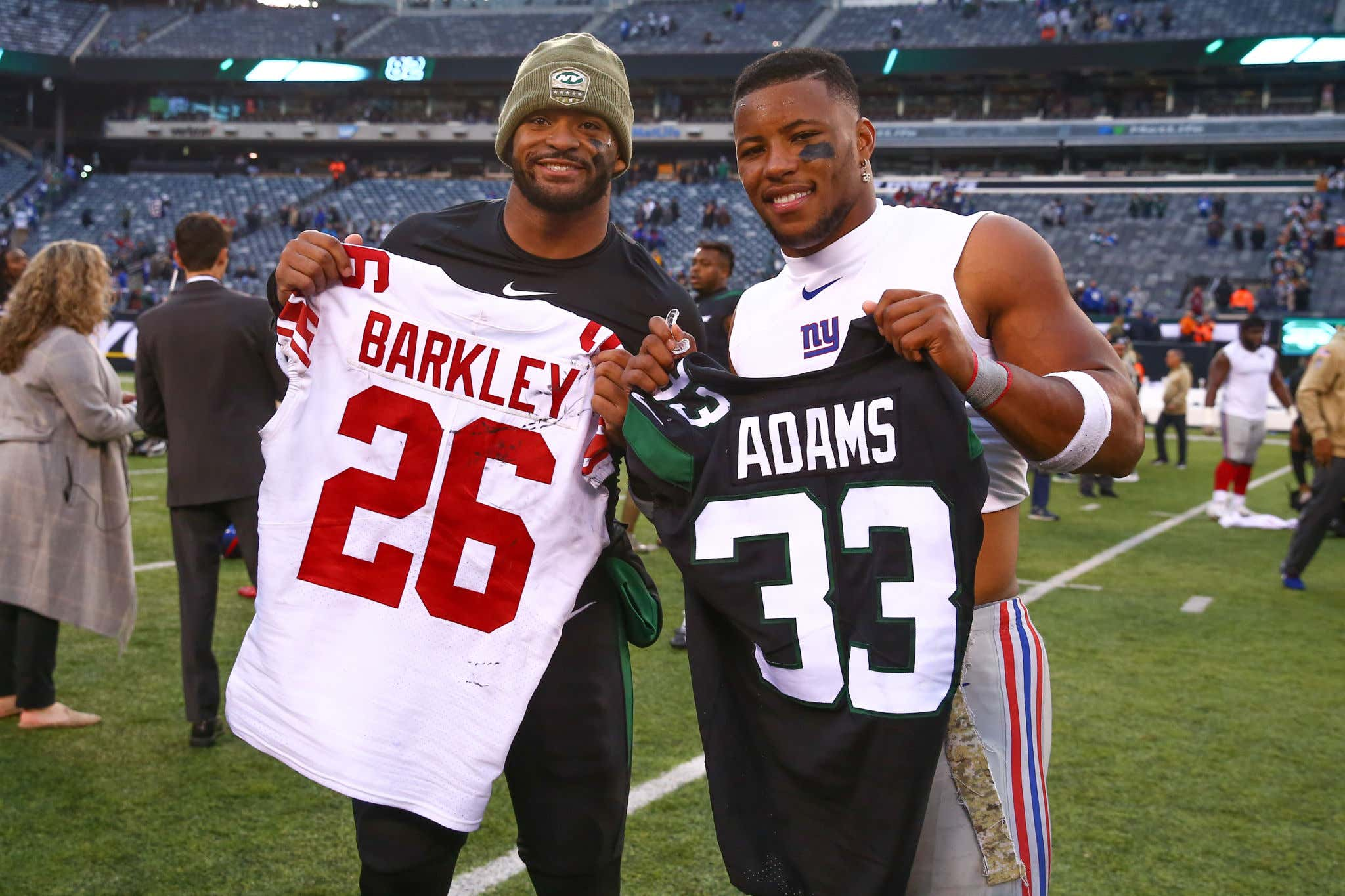 EAST RUTHERFORD, NJ - NOVEMBER 10:  New York Jets strong safety Jamal Adams (33) and New York Giants running back Saquon Barkley (26) swap jerseys after the National Football League game between the New York Jets and the New York Giants on November 10, 2019 at MetLife Stadium in East Rutherford, NJ.  (Photo by Rich Graessle/Icon Sportswire via Getty Images)