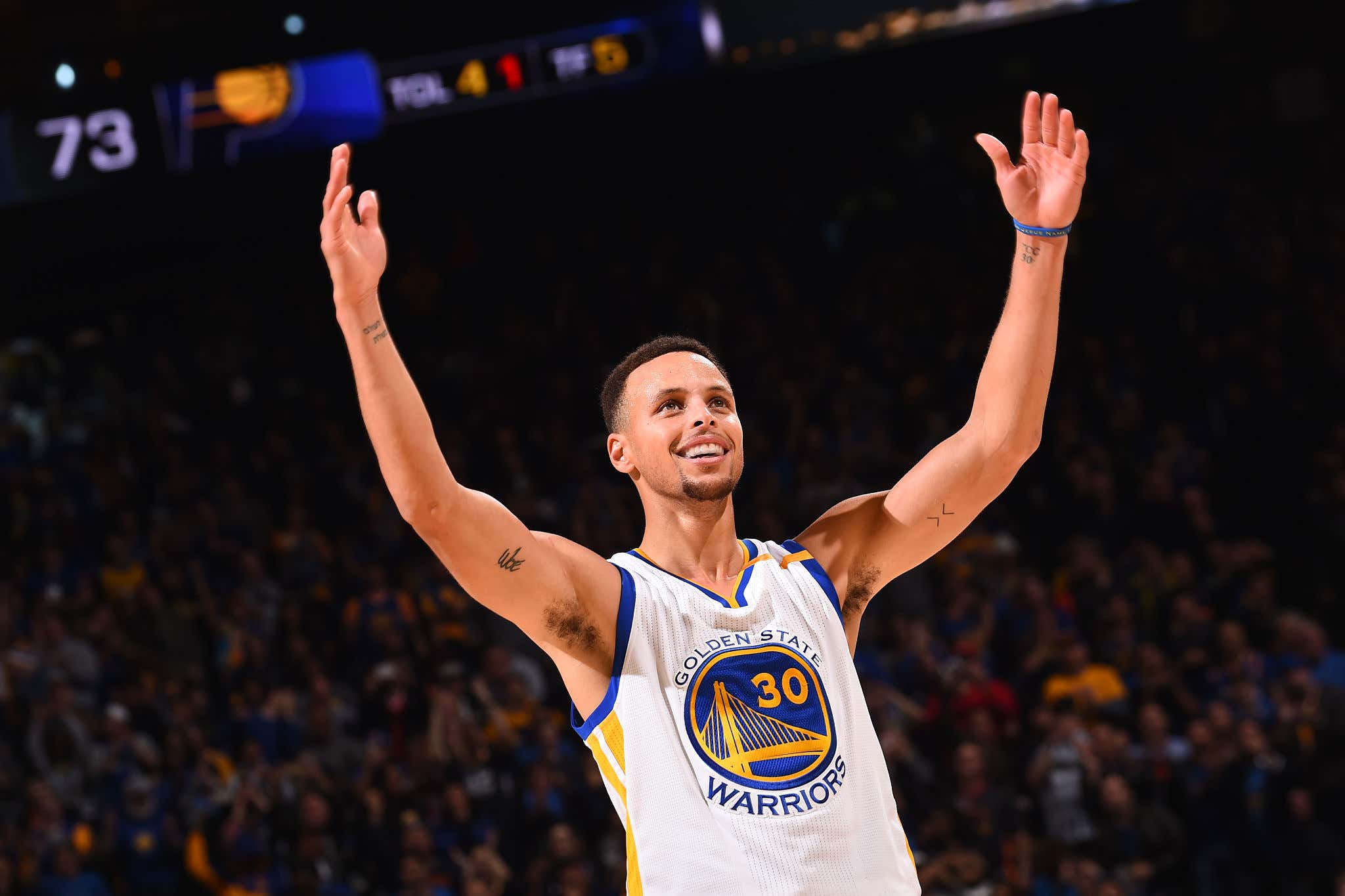 OAKLAND, CA - DECEMBER 5:  Stephen Curry #30 of the Golden State Warriors smiles and gets the crowd into the game against the Indiana Pacers on December 5, 2016 at ORACLE Arena in Oakland, California. NOTE TO USER: User expressly acknowledges and agrees that, by downloading and or using this photograph, user is consenting to the terms and conditions of Getty Images License Agreement. Mandatory Copyright Notice: Copyright 2016 NBAE (Photo by Noah Graham/NBAE via Getty Images)