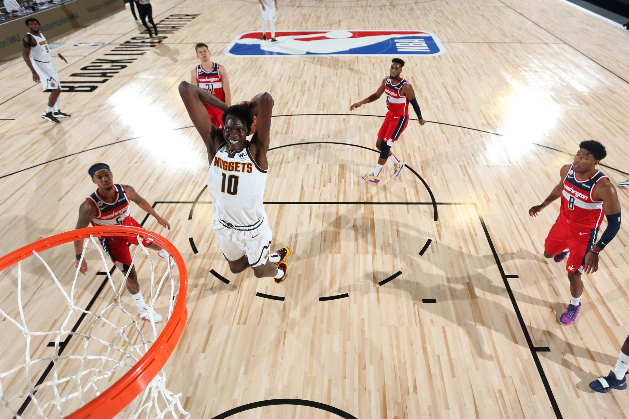 Orlando, FL - JULY 22: Bol Bol #10 of the Denver Nuggets drives to the basket against the Washington Wizards during a scrimmage on July 22, 2020 at The Arena at ESPN Wide World of Sports in Orlando, Florida. NOTE TO USER: User expressly acknowledges and agrees that, by downloading and/or using this Photograph, user is consenting to the terms and conditions of the Getty Images License Agreement. Mandatory Copyright Notice: Copyright 2020 NBAE (Photo by David Dow/NBAE via Getty Images)