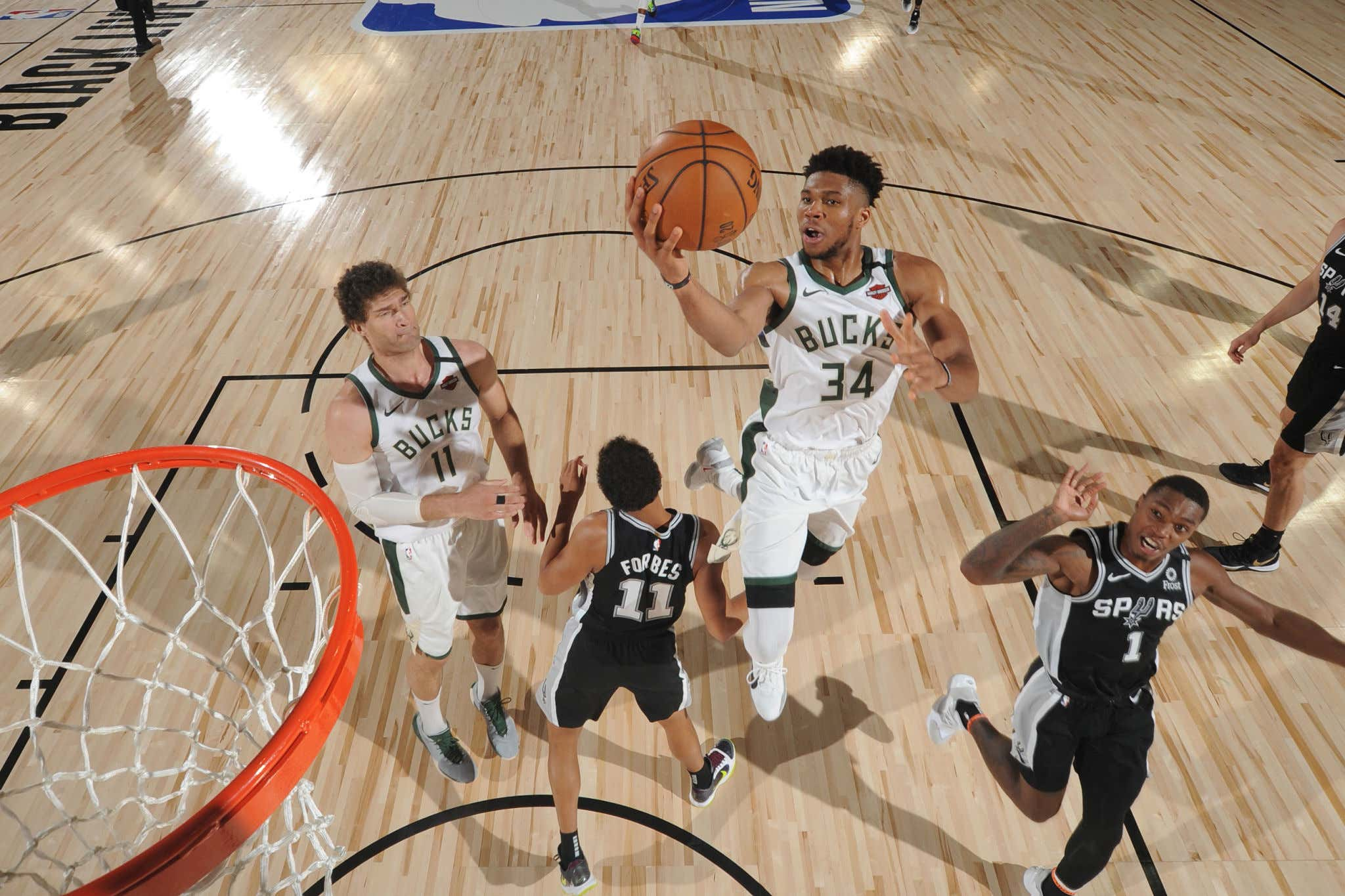 Orlando, FL - JULY 23: Giannis Antetokounmpo #34 of the Milwaukee Bucks shoots the ball against the San Antonio Spurs during a scrimmage on July 23, 2020 at Visa Athletic Center at ESPN Wide World of Sports in Orlando, Florida. NOTE TO USER: User expressly acknowledges and agrees that, by downloading and/or using this Photograph, user is consenting to the terms and conditions of the Getty Images License Agreement. Mandatory Copyright Notice: Copyright 2020 NBAE (Photo by Jesse D. Garrabrant/NBAE via Getty Images)