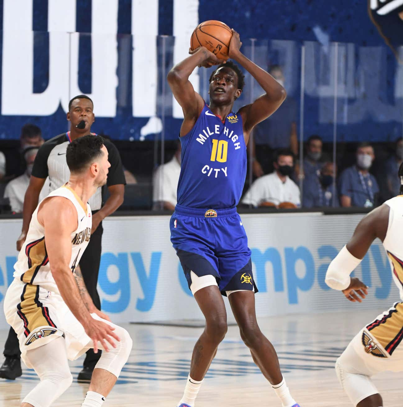 Orlando, FL - JULY 25: Bol Bol #10 of the Denver Nuggets shoots the ball against the New Orleans Pelicans during a scrimmage on July 25, 2020 at The Arena at ESPN Wide World of Sports in Orlando, Florida. NOTE TO USER: User expressly acknowledges and agrees that, by downloading and/or using this Photograph, user is consenting to the terms and conditions of the Getty Images License Agreement. Mandatory Copyright Notice: Copyright 2020 NBAE (Photo by Garrett Ellwood/NBAE via Getty Images)