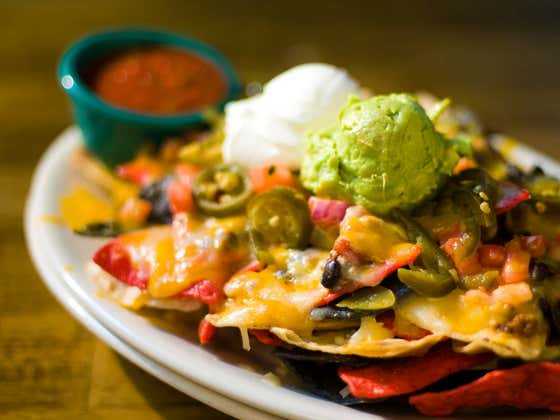 Restaurants Really Need To Start Adding More Than Just One Layer Of Melted Cheese To Nachos