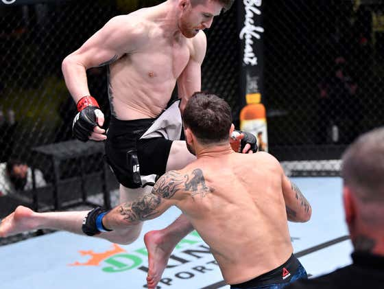 CORY SANDHAGEN KNOCKS FRANKIE EDGAR OUT WITH AS GOOD A FLYING KNEE AS YOU'LL EVER SEE