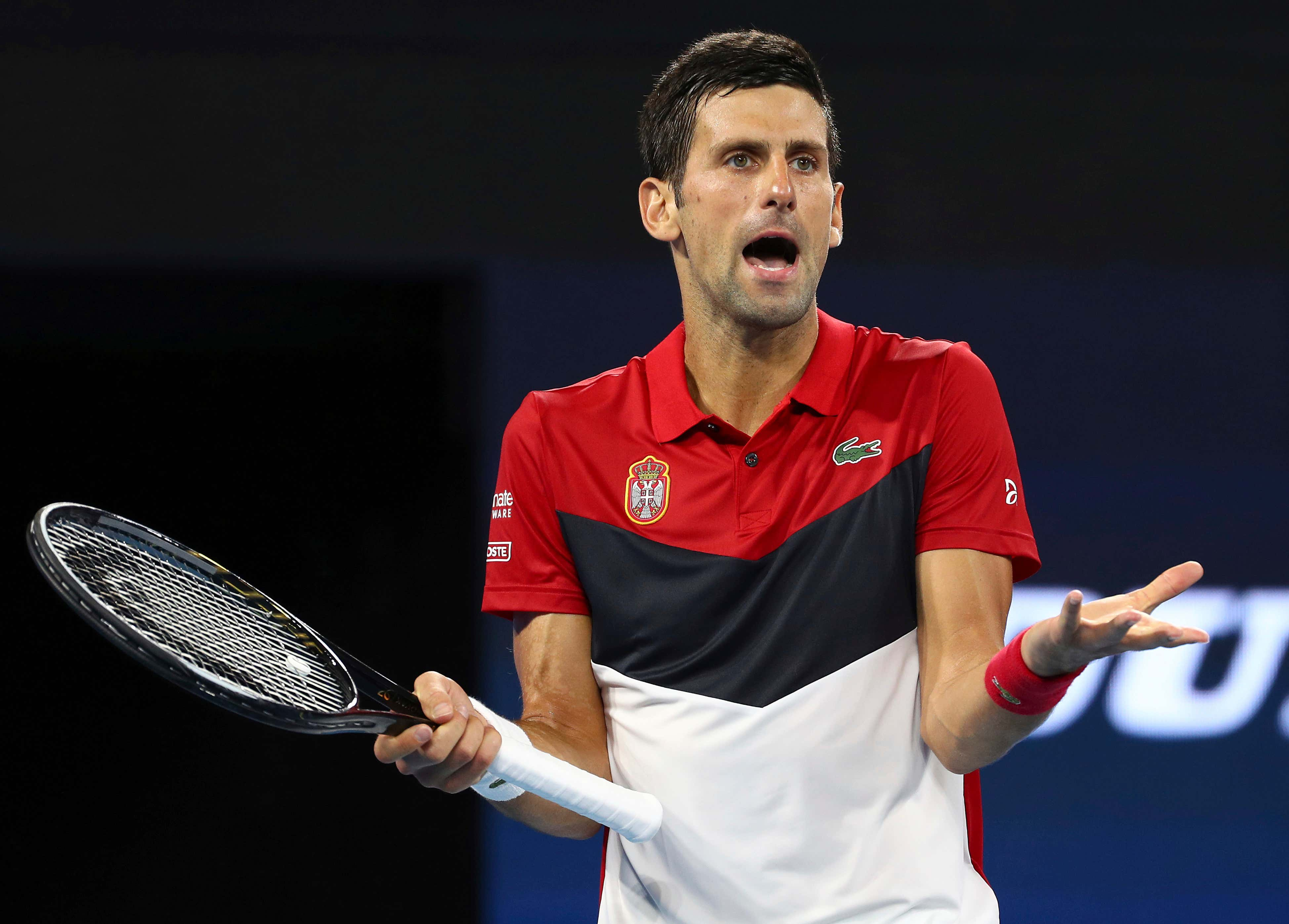 Novak Djokovic, ATP Cup 2020. Novak Djokovic of Serbia reacts after being heckled by a spectator during his match against Kevin Anderson of South Africa at the ATP Cup tennis tournament in Brisbane, Australia
