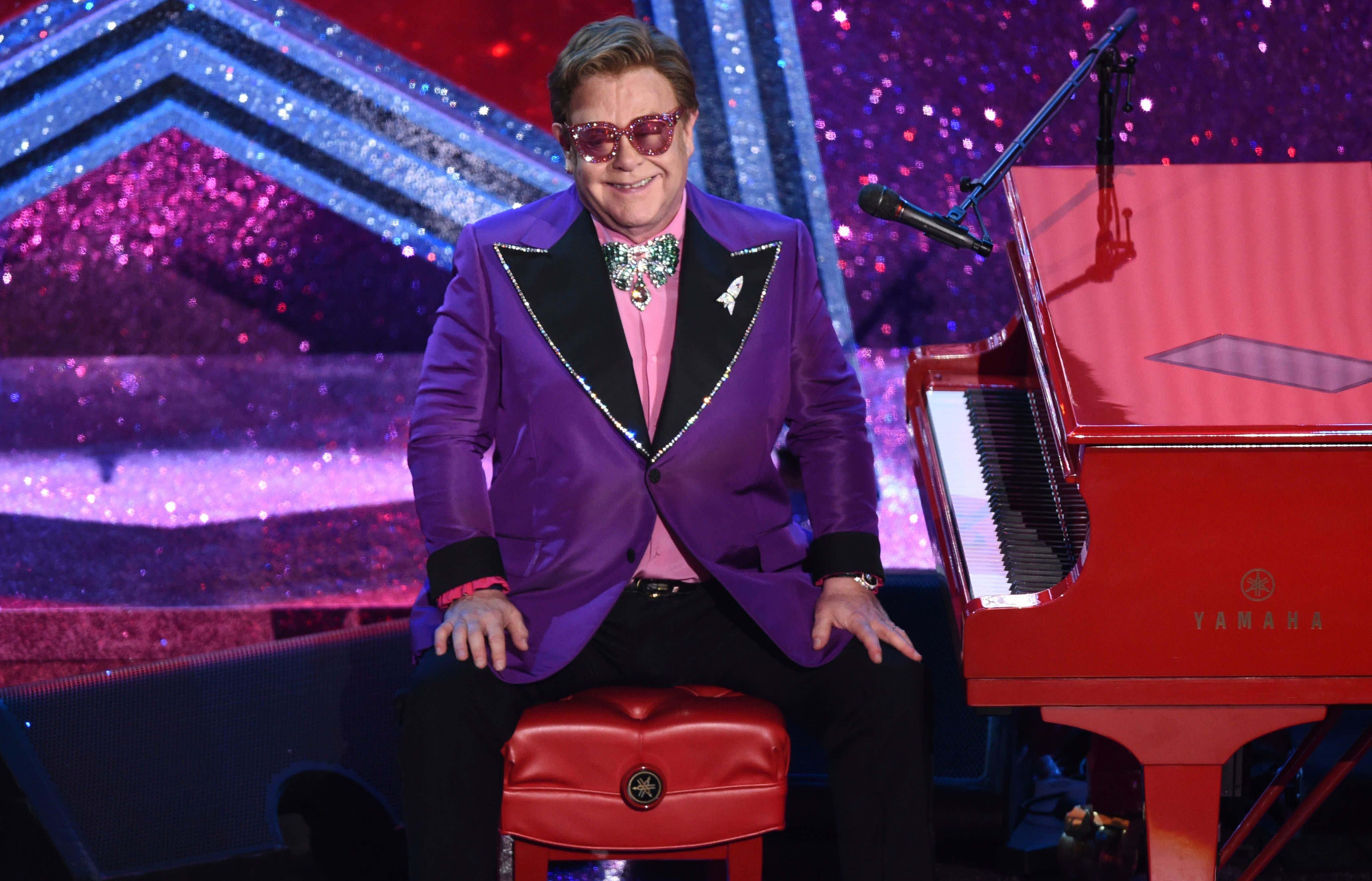 Elton John appears after performing his nominated song,