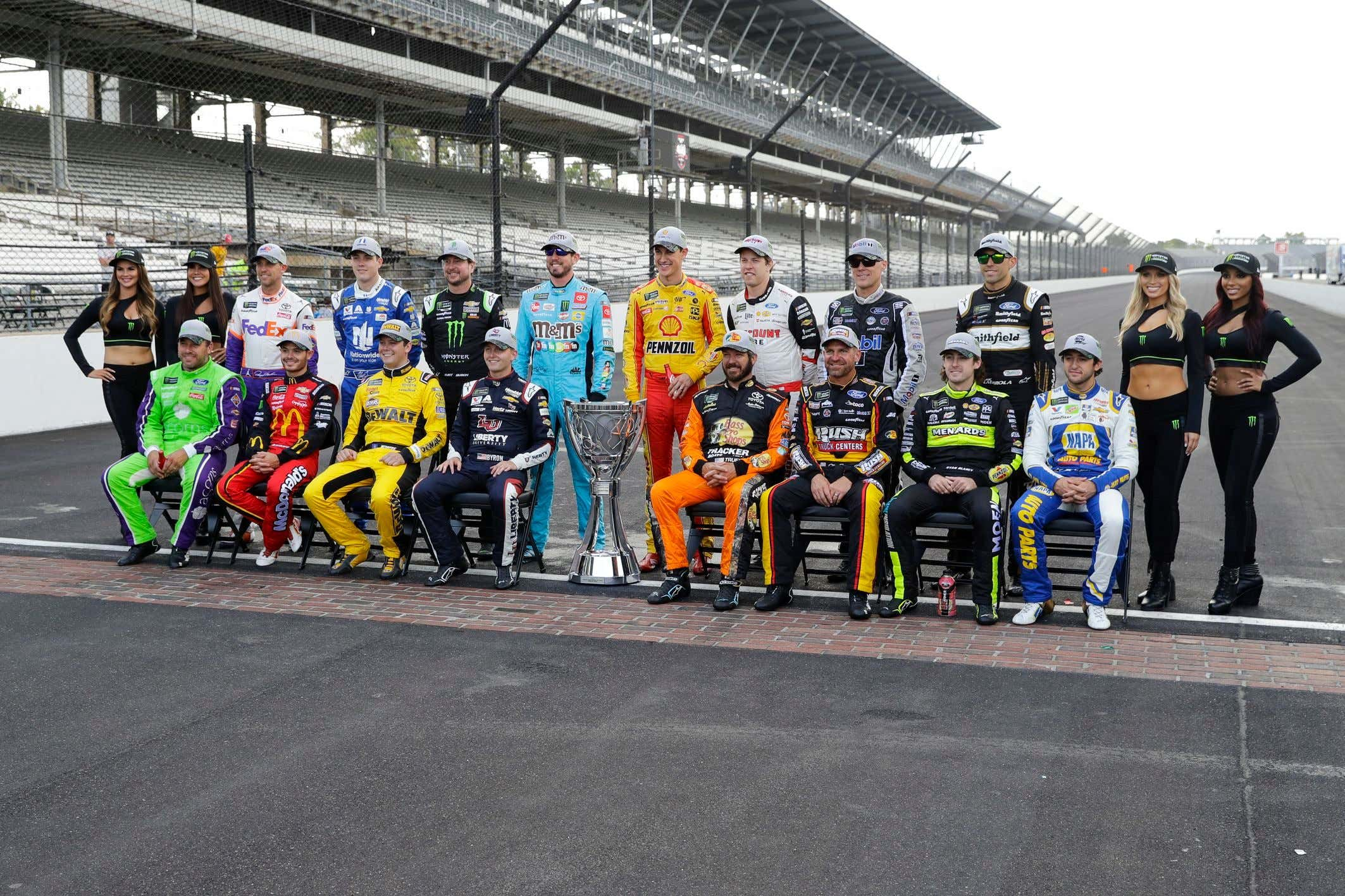 Drivers who qualified the NASCAR Cup Series playoff pose on the the start/finish line following the Brickyard 400 auto race at Indianapolis Motor Speedway, in Indianapolis