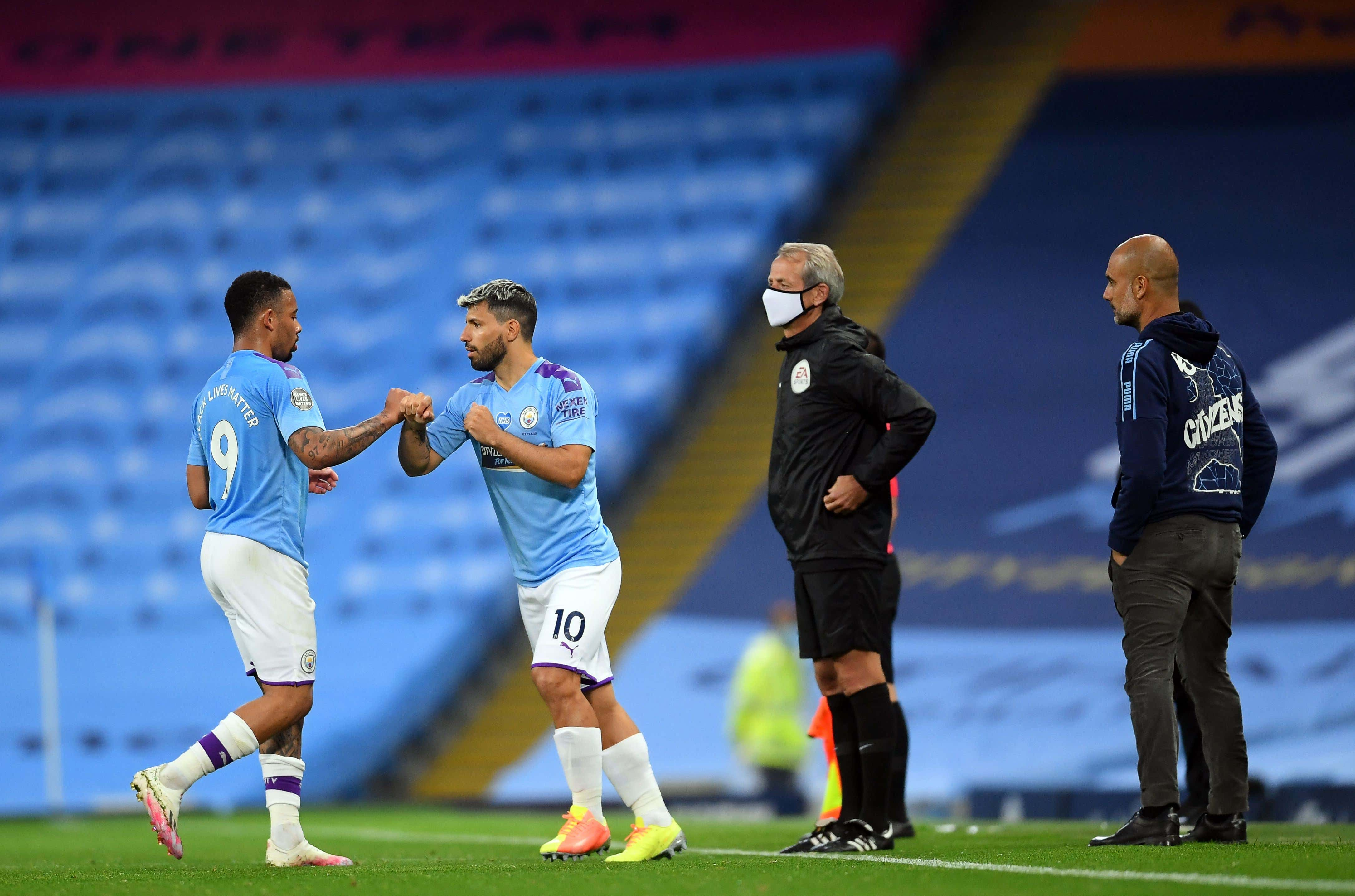Gabriel Jesus (L) of Manchester City leaves the pitch for his teammate Sergio Aguero (2-L) as Manchester City manager Pep Guardiola (R) looks on during the English Premier League soccer match between Manchester City and Arsenal FC at Etihad stadium in Manchester, Britain, 17 June 2020.