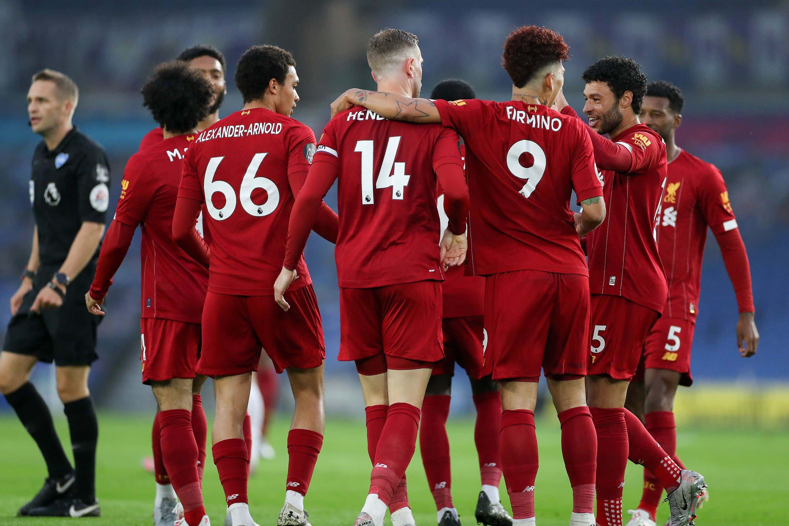 GOAL 0-2 Liverpool midfielder Jordan Henderson (14) celebrates with Liverpool forward Roberto Firmino (9) Liverpool defender Trent Alexander-Arnold (66)and Liverpool midfielder Alex Oxlade-Chamberlain (15) during the Premier League match between Brighton and Hove Albion and Liverpool at the American Express Community Stadium, Brighton and Hove