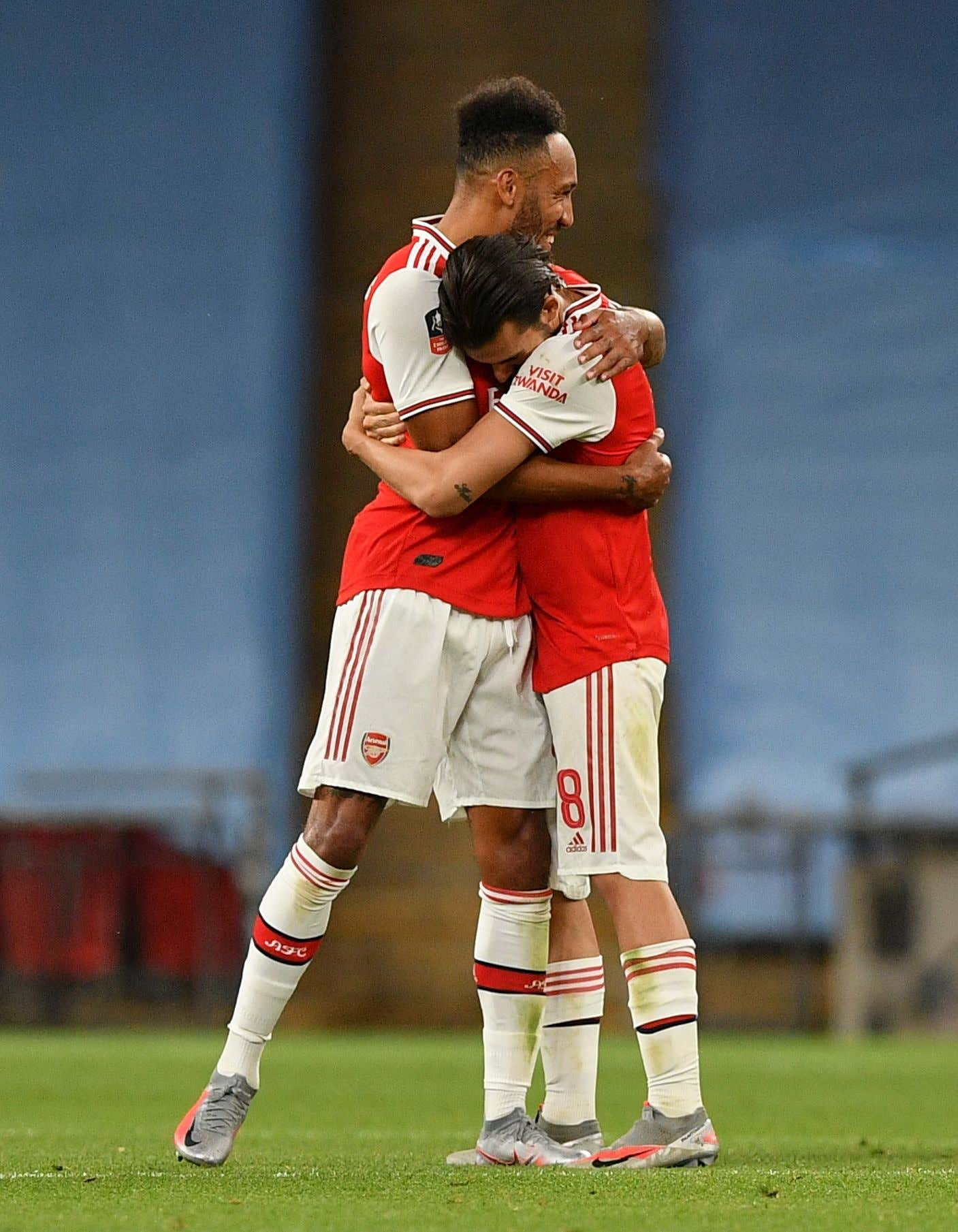 Pierre-Emerick Aubameyang of Arsenal (L) and Dani Ceballos of Arsenal (R) celebrate after the English FA Cup semi final match between Manchester City and Arsenal London at the Wembley Stadium in London, Britain, 18 July 2020.