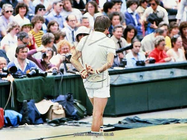 1977 Wimbledon Championships  The USA's Jimmy Connors gives a rude gesture behind his back while talking to the umpire on Centre Court.
