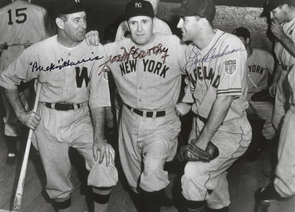 American League All Star Manager Joe McCarthy surrounded by Bucky Harris of the Washington Senators and Lou Boudreau of the Cleveland Indians at the 1942 All-Star Game at the Polo Grounds in New York
