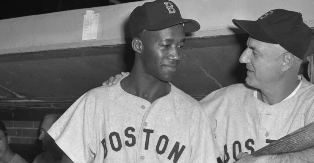 Pumpsie Green getting encouragement from Manager Billy Jurges upon his debut with the Boston Red Sox