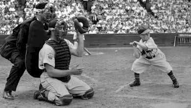 Tigers Catcher Bob Swift catches a ball thrown to Eddie Gaedel of the St. Louis Browns who was walked in his only plate appearance.