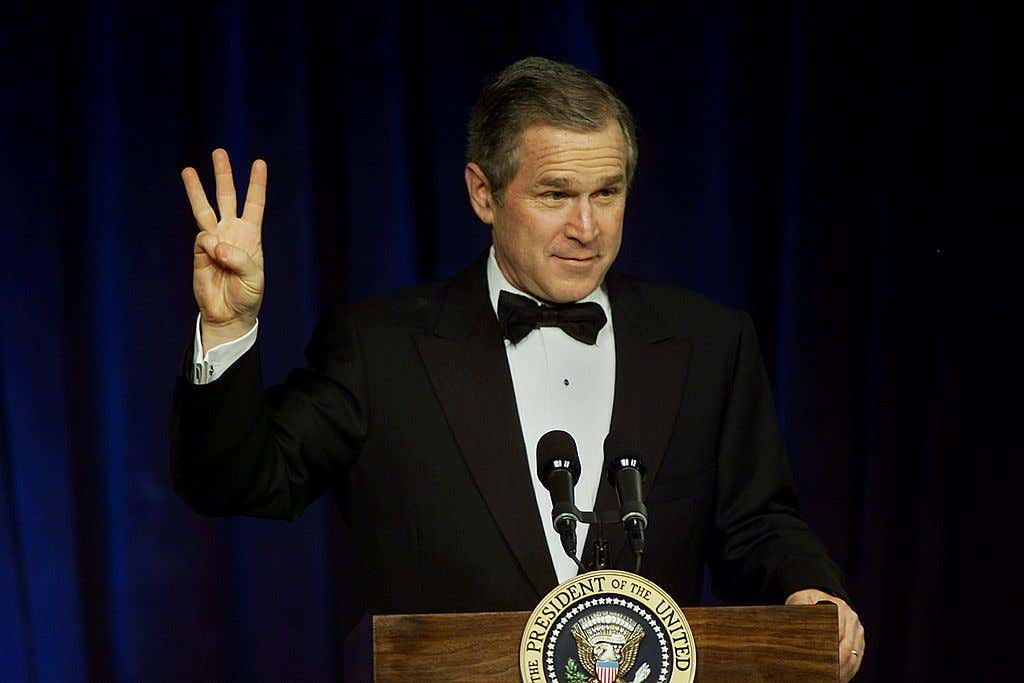 US President George W. Bush flashes the
