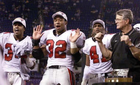 Running back Jamal Anderson (2ndL) of the Atlanta