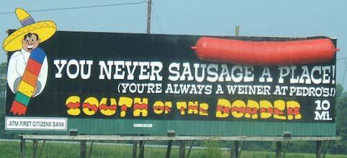 800px-south_of_the_border_sign_10_-_you_never_sausage_a_place