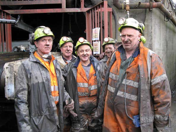 Miners at a coal mine in the village of