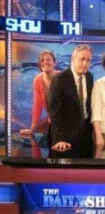 Creepily lurking behind Jon Stewart