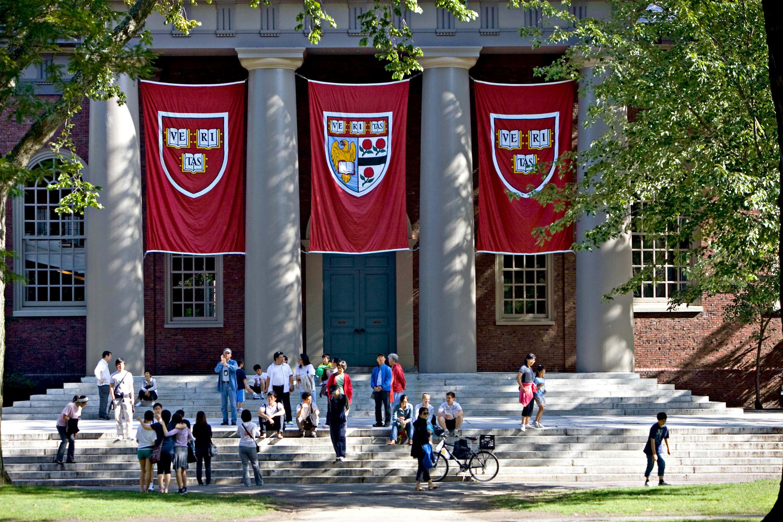 Harvard banners hang outside Memorial Church on the Harvard