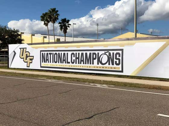"""UCF Fan Named Chad Will Fly A """"13-0 National Champions"""" Banner Over Camping World Stadium Before Alabama-Louisville"""