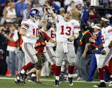 New York Giants Manning celebrates with teammates after his game winning touchdown pass in NFL's Super Bowl XLII against New England Patriots in Glendale