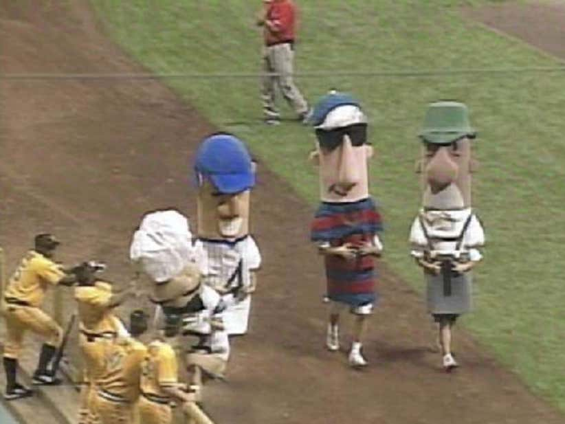 Wake Up With Randall Simon Assaulting A Sausage During The Sausage Race During A Milwaukee Brewers Game