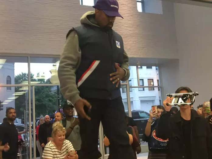 6dd35def55e Kanye Jumped On A Table At An Apple Store To Give A