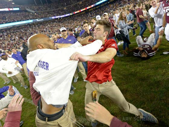 LSU's Kevin Faulk & Texas A&M Fan Throw Hands Postgame At Midfield