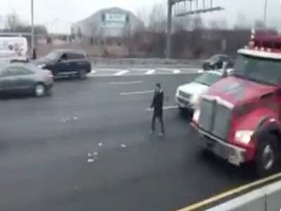 It's A Christmas Miracle! Brinks Truck Spills Money Onto New Jersey Highway And Commuters Leave Their Cars To Pick It Up