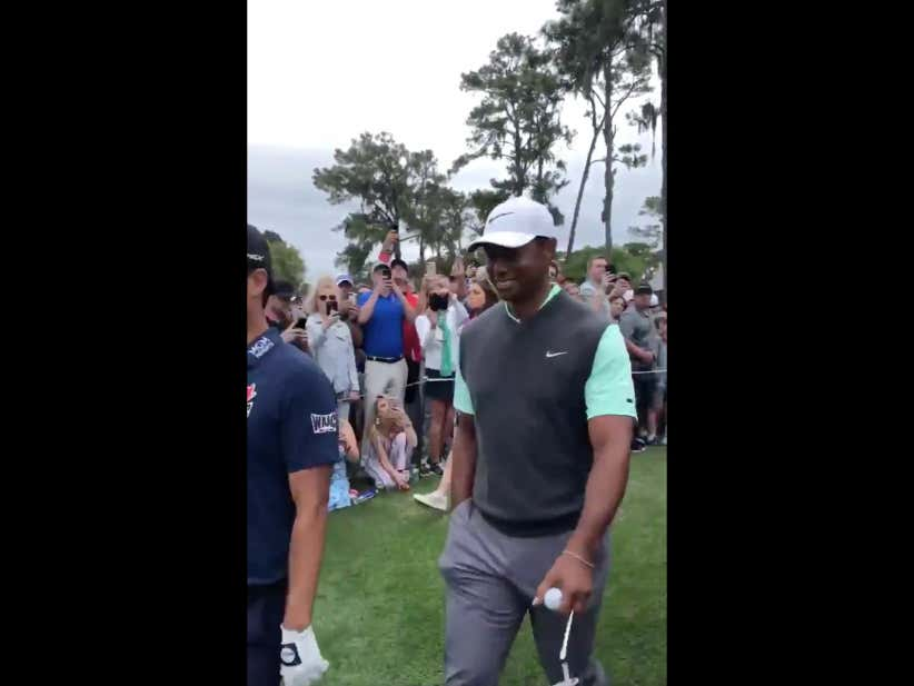 Tiger Woods Tried Really Hard Not To Laugh At A Guy With His Mugshot On His Shirt