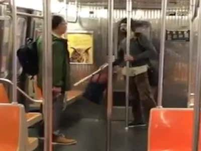 Man Brings A Bat And A Whole Bunch Of Crazy To A Gun Fight On The Subway In The Most New York Video Ever
