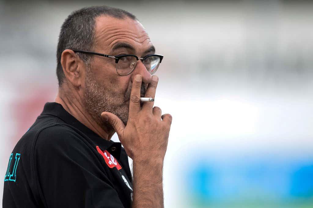 Maurizio Sarri, head coach of SSC Napoli, smokes a cigarette