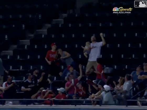 Elite Dad And Phillies Fan Has A Baby In One Hand And Catches A Foul Ball In The Other