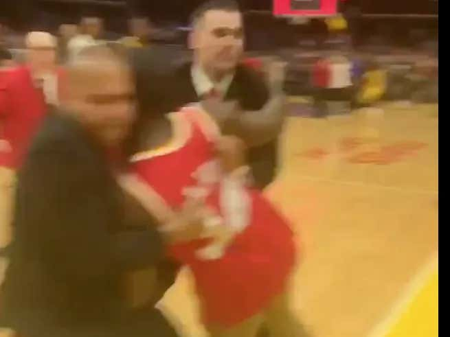 A Guy Stormed The Court After Doing Pushups On The Sidelines During The WNBA Playoffs And Got Absolutely BUNDLED By Security